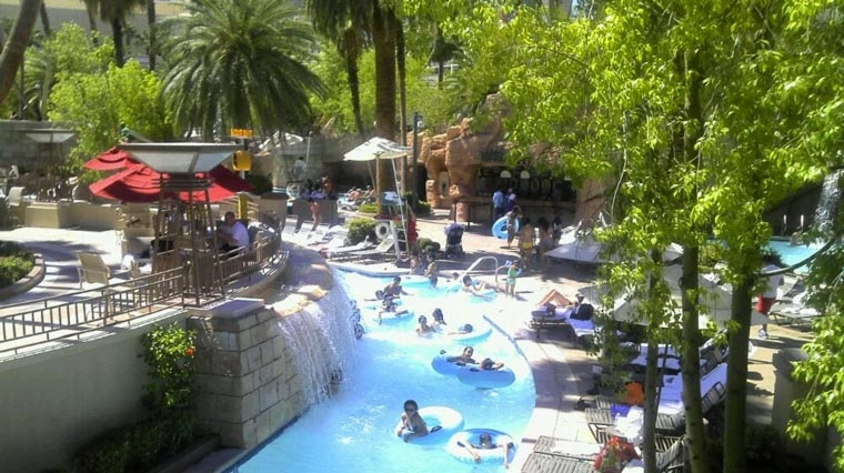 Inner tube lazy river pool party MGM